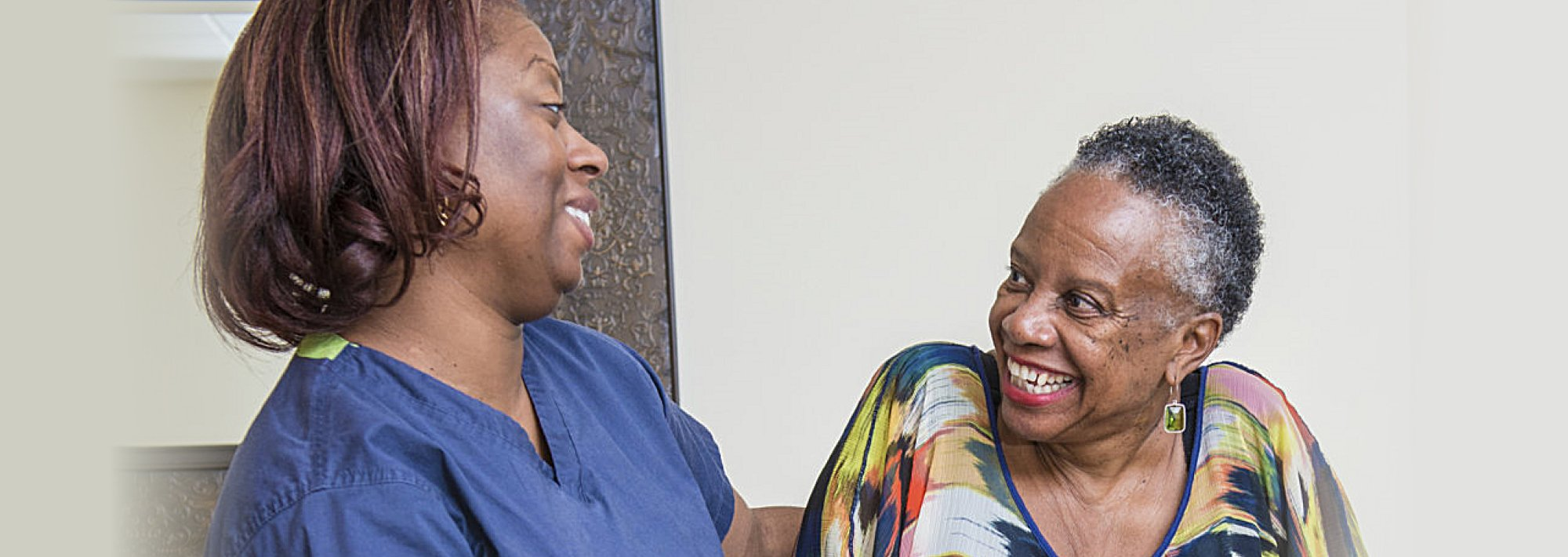 Caregiver and senior talking to each other